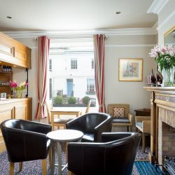Guest lounge and honsety bar in central cheltenham
